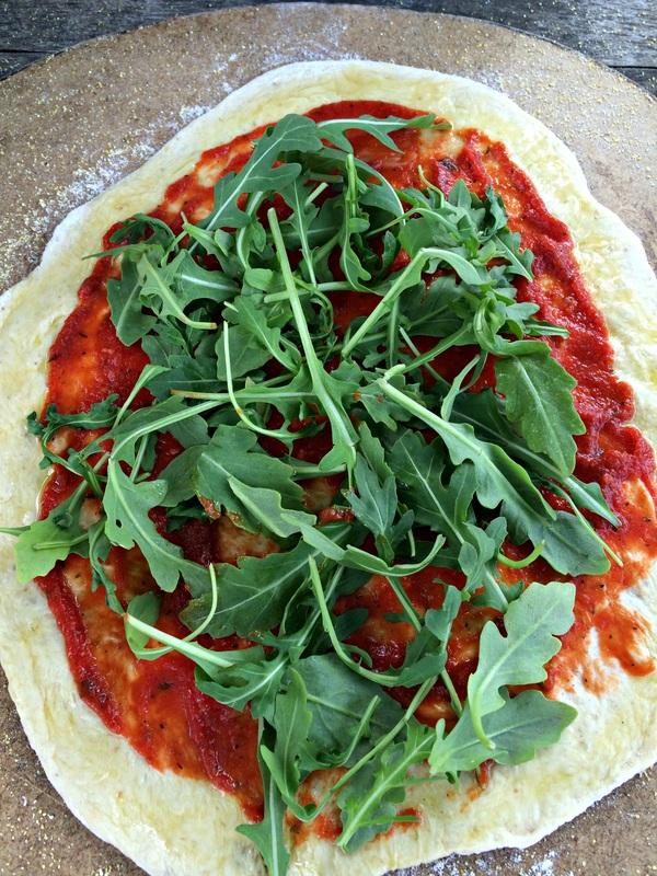 Arugula and Sauce on Tomato and Arugula Pizza ~ The Complete Savorist