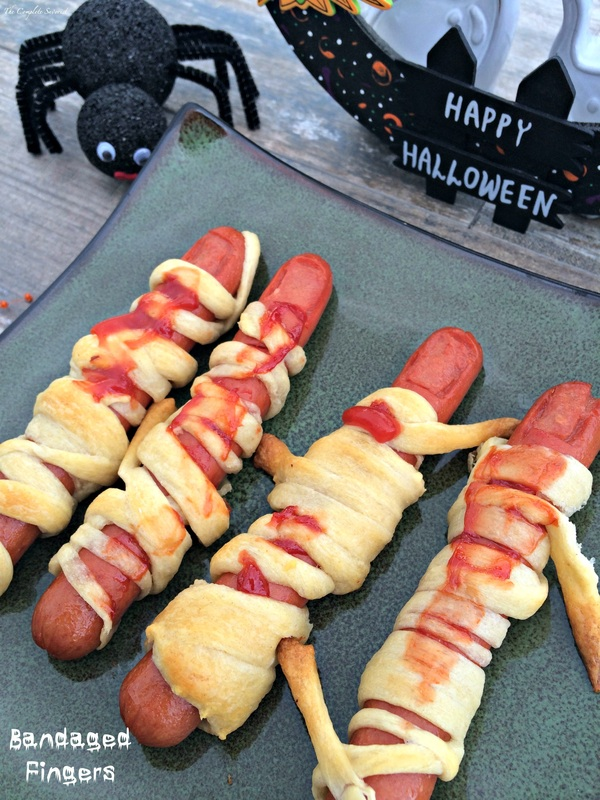 Bandaged Fingers (Halloween Hot Dogs) - Creepy looking hot dogs cut into fingers, wrapped in delicious crescent rolls and covered in ketchup, perfect for your holiday party or for just freaking out your kids.