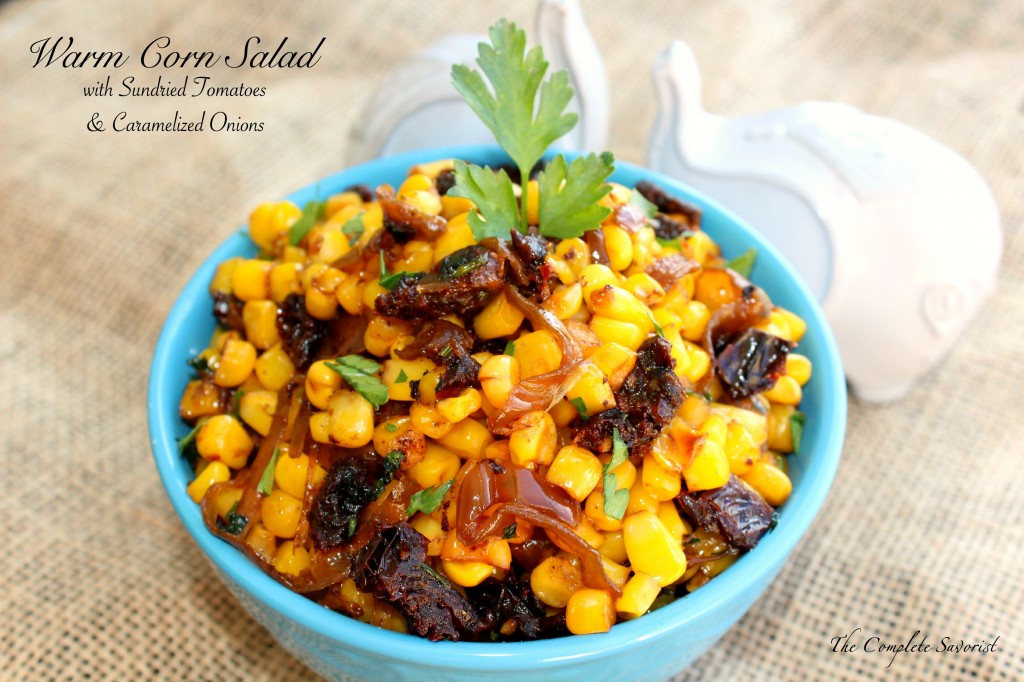 Warm Corn Salad - Skillet seared corn tossed with sundried tomatoes, caramelized onions, fresh parsley and made silky with a small amount of cream ~ The Complete Savorist