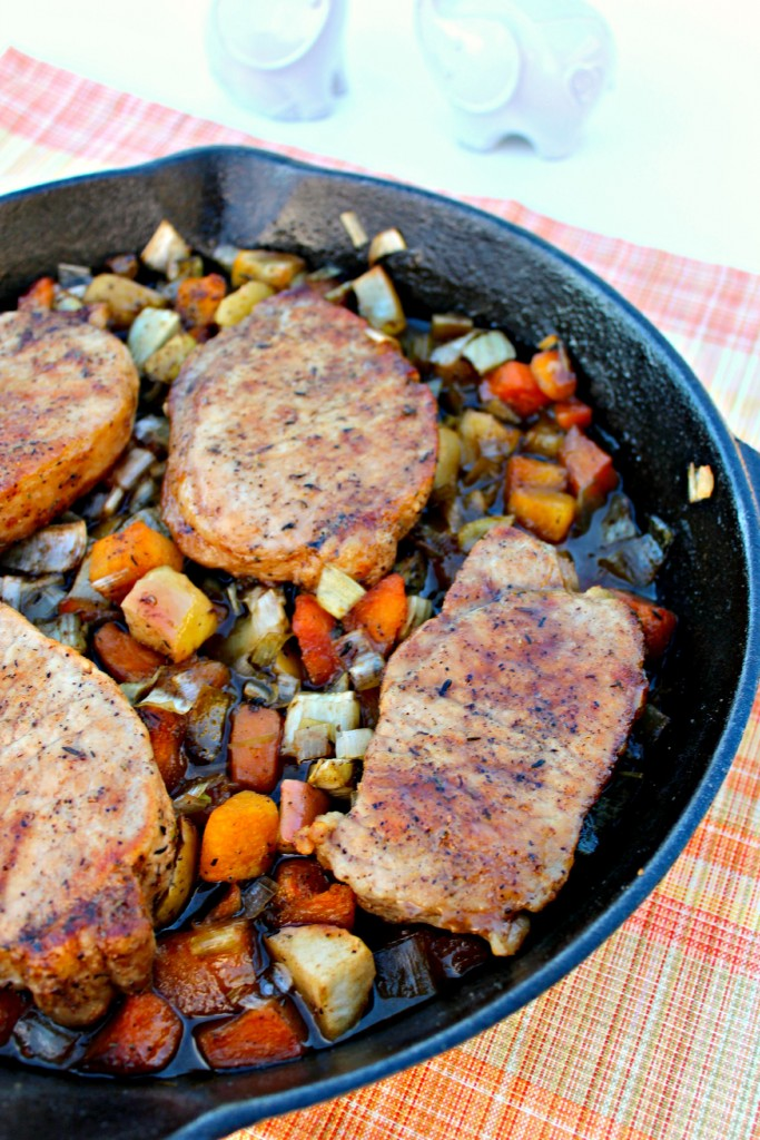Pork Chops with Glazed Apples and Vegetables ~ Pan seared, thick cut pork chops oven roasted with apples, leeks, fennel, and butternut squash glazed in a herb brown sugar sauce ~ The Complete Savorist