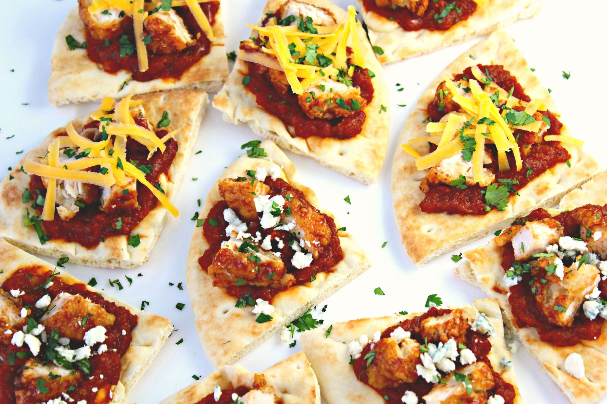 BBQ Chicken Pita Bites ~ Toasted Pita bread slathered with tomato bacon jam and chopped BBQ chicken pieces, then finished with cilantro and bleu or cheddar cheese ~ The Complete Savorist #GameDaySnackHacks ad