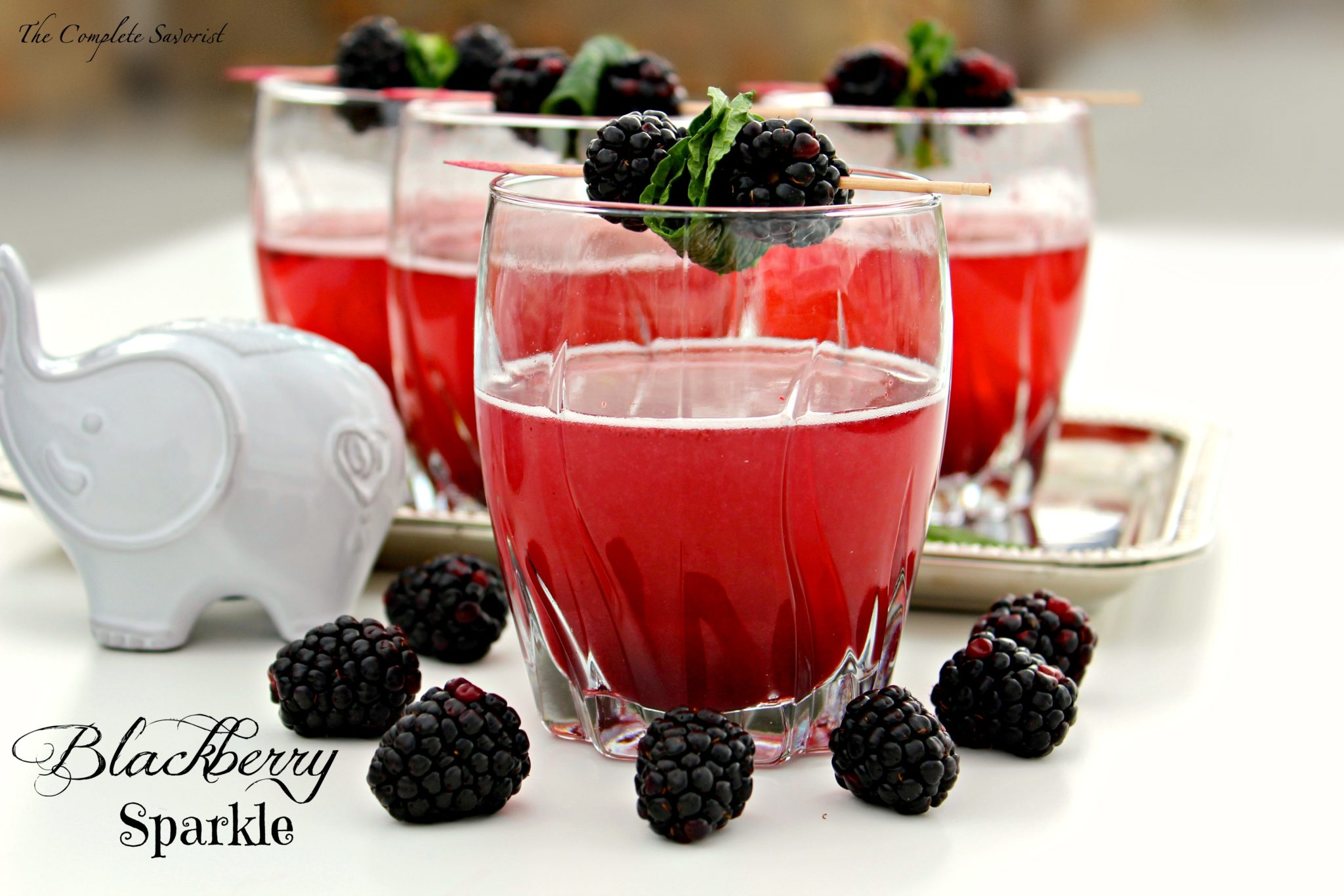 Blackberry Sparkle ~ A sparkling cocktail with Prosecco, ginger ale, and blackberry sauce ~ The Complete Savorist