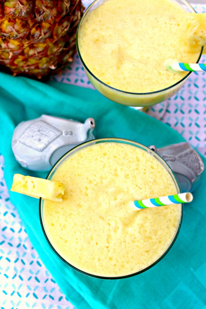 Frozen Pineapple Margarita ~ The classic blended margarita gets a tropical update with fresh pineapple transporting you to the nearest island ~ The Complete Savorist