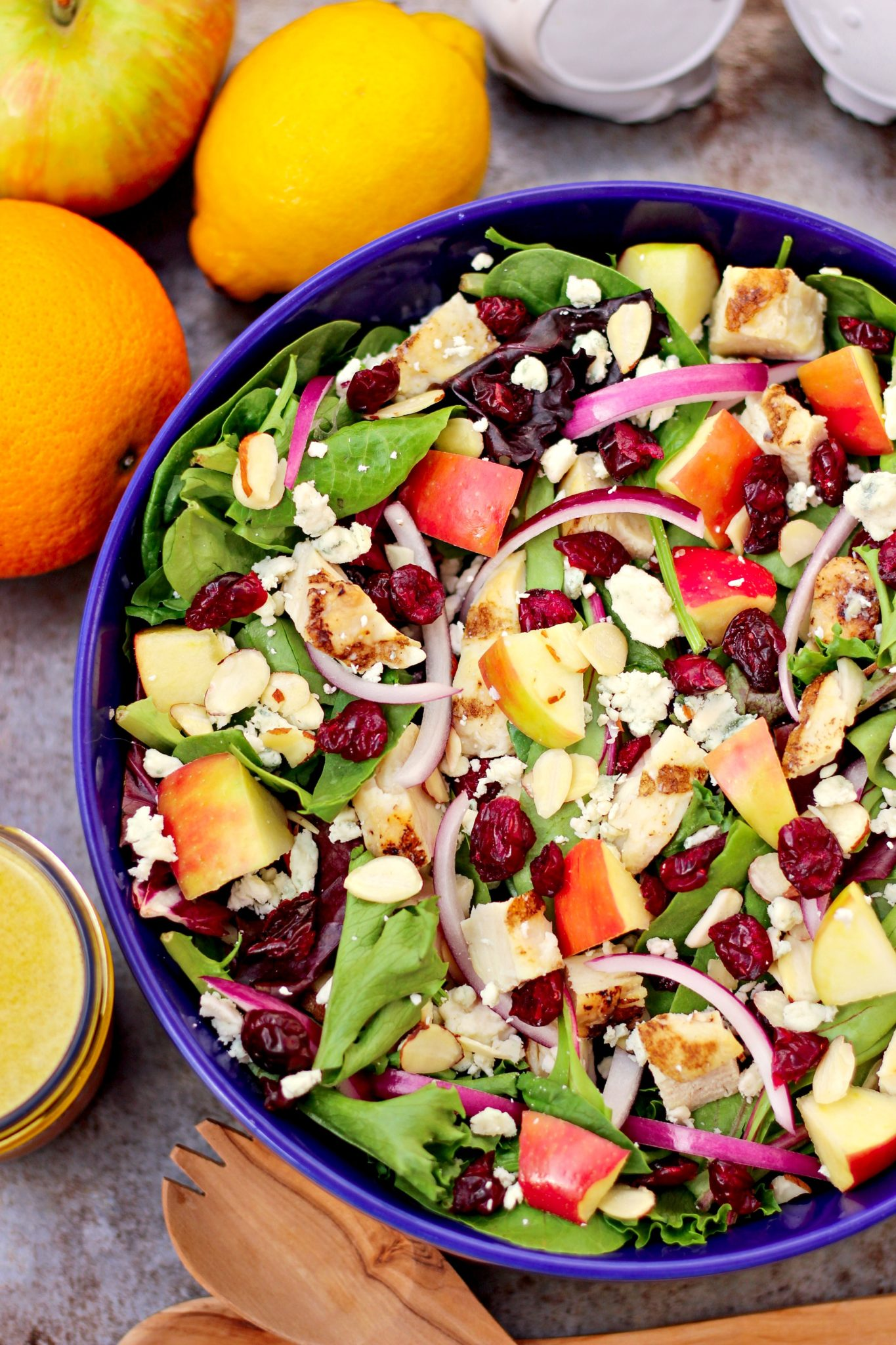 Grilled Chicken Cranberry Salad with Citrus Vinaigrette ~ Fresh bed of salad greens topped with dried cranberries, grilled chicken, blue cheese, apples and a citrus vinaigrette ~ The Complete Savorist #BetterWithCraisins ad